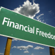 Stock Photo: Financial Freedom Road Sign