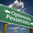Optimists, Pessimists Green Road Sign - Stock Photo