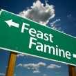 Feast or Famine Green Road Sign — Photo