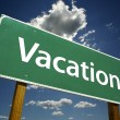 Vacation Green Road Sign — Stock Photo