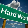 Hard Work Green Road Sign - Stock Photo