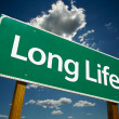 Stock Photo: Long Life Green Road Sign