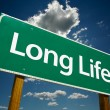 Long Life Green Road Sign - Stock Photo