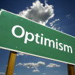 Optimism Green Road Sign - Stock Photo