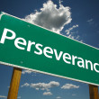 Perseverance Green Road Sign - Stock Photo
