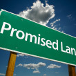 Promised Land Green Road Sign - Stock Photo