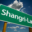 Shangri-La Green Road Sign - Stock Photo
