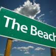 The Beach Green Road Sign - Stock Photo