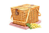 Picnic Basket, Grapes and Folded Blanket — Stock Photo