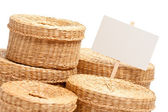 Various Wicker Baskets with Blank Sign — Stock Photo