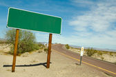 Blank Green Road Sign On Desert Road — Stock Photo