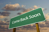 Come Back Soon Green Road Sign — Stock Photo
