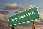 Enjoy Your Visit Green Road Sign — Stock Photo