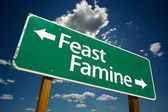 Feast or Famine Green Road Sign — Stock Photo