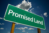 Promised Land Green Road Sign — Stock Photo