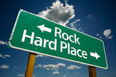 Rock and Hard Place Green Road Sign — Stock Photo