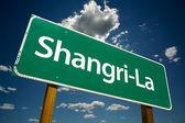 Shangri-La Green Road Sign — Stock Photo