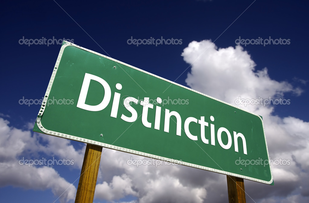 Distinction Road Sign with Dramatic Clouds and Sky.  Stock Photo #2328416