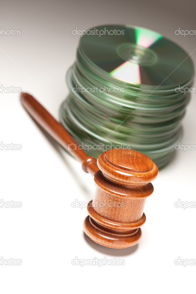 Stack of CD Rom or DVD Discs and Gavel on a Gradated Background. — Stock Photo #2328539