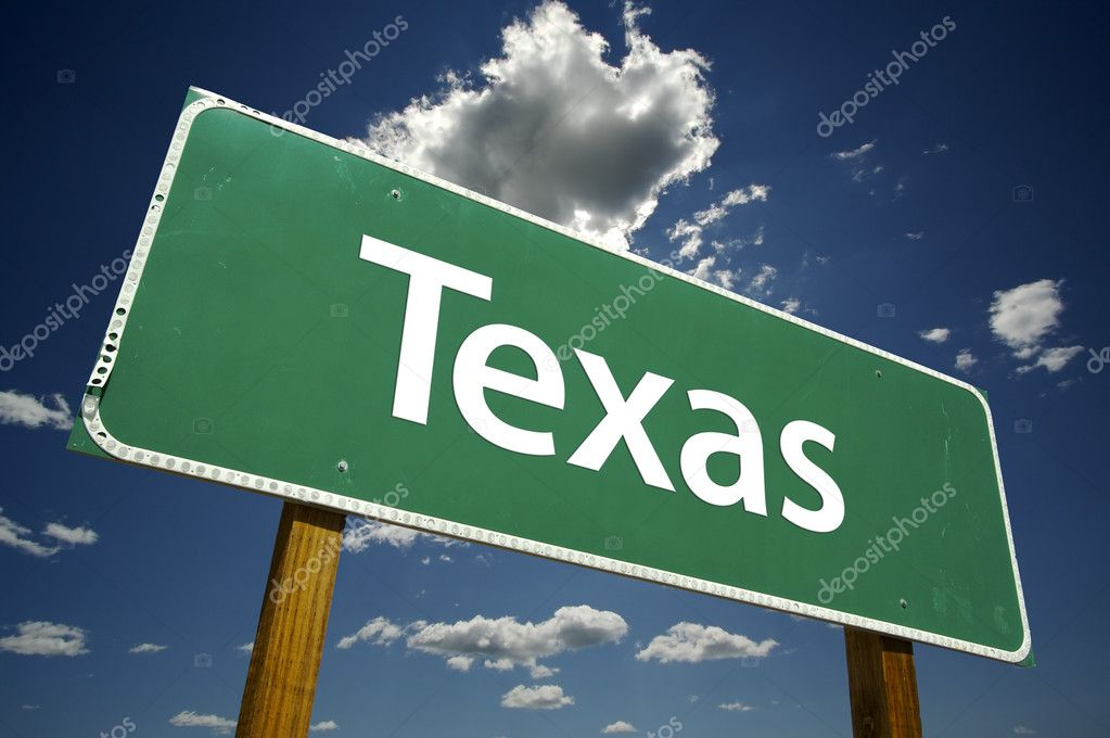 Texas Road Sign with dramatic clouds and sky.  Stock Photo #2329082