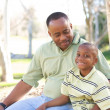 Man and Child Having fun in the park. — Stock Photo