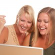 Two Laughing Women Using Laptop Isolated — Stock Photo