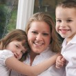 Mother and Children Enjoy a Fun Moment — Stock Photo