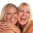 Two Beautiful Hugging Sisters Laughing — Stock Photo