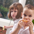 Sister and Brother Having Fun Eating — Stock Photo