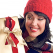 Pretty Brunette Holds Holiday Gift — Stock Photo #2343428