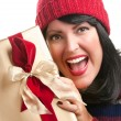 Happy Attractive Lady Holds Holiday Gift - Stock Photo