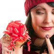 Brunette Woman Holds Holiday Gift - Stok fotoğraf
