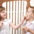 Sister and Brother Feed Eachother Fruit — Stock Photo