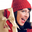 Excited Woman Holds Holiday Gift — Stock Photo