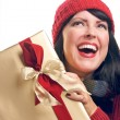 Elated Brunette Holds Holiday Gift — Stock Photo