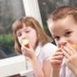 Sister and Brother Eating a Snack — Stock Photo #2343550