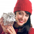 Stock Photo: Brunette Girl Holds Holiday Gift