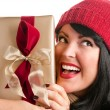 Brunette Woman Holds Holiday Gift — Stock Photo #2343696