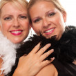 Stock Photo: Portrait of Two Blonde Girls in Boas