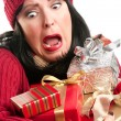 Royalty-Free Stock Photo: Nervous Woman Balances Many Gifts