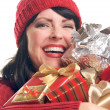 Smiling Woman Holds Holiday Gifts — Stock Photo #2343804