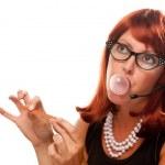 Red Head Retro Receptionist Chews Gum — Stock Photo #2343859