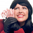 Woman on White Holding Candy Canes — Stock Photo