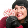 Woman on White Holding Candy Canes - Stock Photo