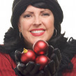 Attractive Woman Holding Red Ornaments - Stock Photo