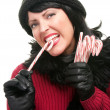 Stock Photo: Cute Brunette Holds Candy Canes Isolated