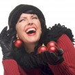 Laughing Woman Holding Red Ornaments — Stock Photo #2344312