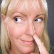 Blond Woman with Finger in Her Nose — Stock Photo
