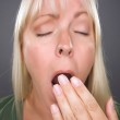 Yawning Blond Woman Against — Stock Photo