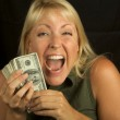 Woman on Black Holding Stack of Money — Stock Photo